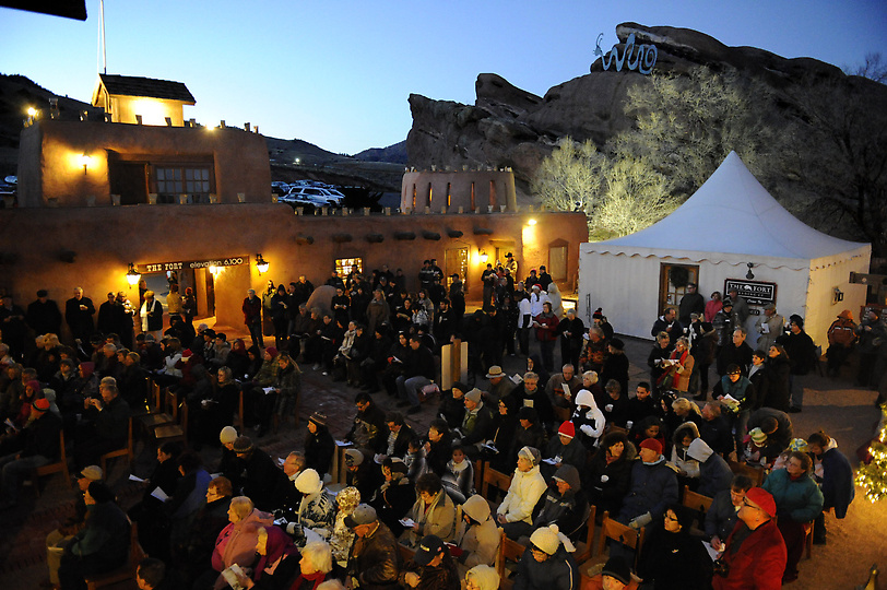 A large crowd gathers in the courtyard of the Fort restaurant for the annual lighting of the farolitos.  The Tesoro Cultural Center celebrated the tradition of the lighting of the farolitos, a yearly event at The Fort restaurant in Morrison Colorado, on November 28, 2011. The southwestern tradition of the lighting of the farolitos has been celebrated in Colorado for the past 24 years.  Families gather from all over Colorado to participate in group caroling, food and drinks and the traditional pinecone lighting ceremony.   Manuel Martinez/Viva Colorado